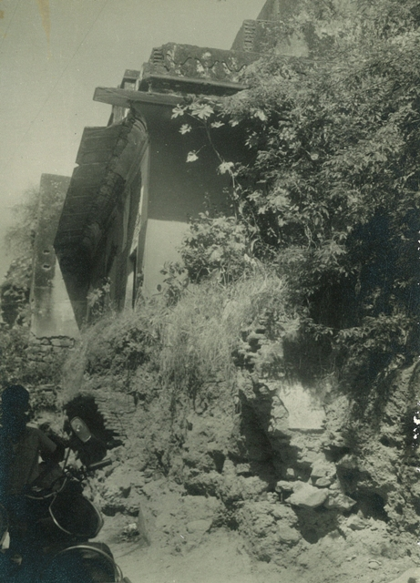a damaged boundary wall behind imam bara in 1960sjpg